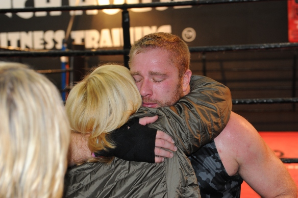 Brian and his mom embrace after his fight